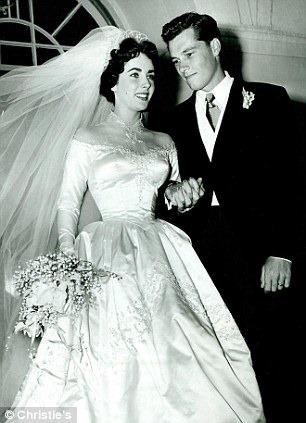 Elizabeth taylor s first wedding dress goes for almost for Elizabeth taylor wedding dress